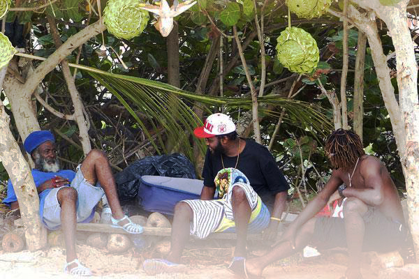 Locals sell souvenirs at Grand Case
