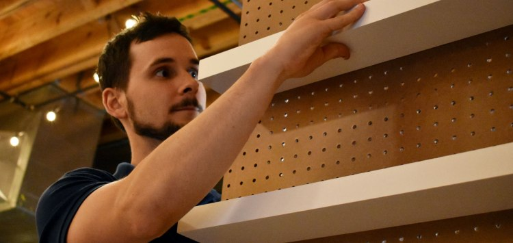 Philip building the pegboard walls