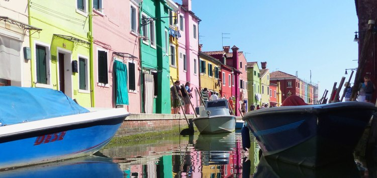 Colorful buildings along the canal in Burano