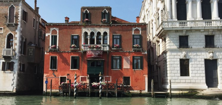 A brightly colored building in Venice
